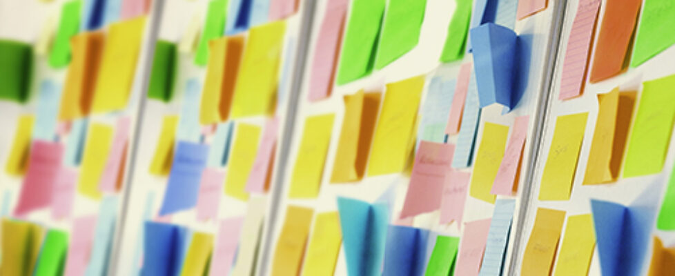 Wall covered with sticky notes
